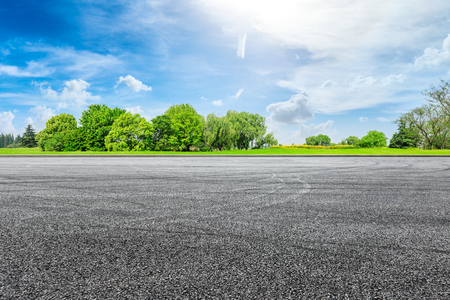 Empty asphalt square ground and green forest in summer 写真素材