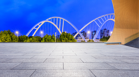 Empty square floor and bridge construction in shanghai at night