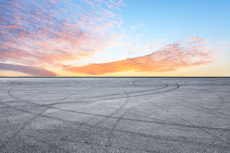 Asphalt race track and sunrise