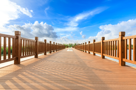 Empty boardwalk and beautiful clouds in city park