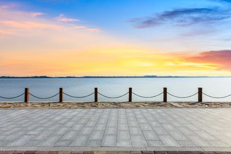 Beautiful lake and walkway with sky clouds at sunset 版權商用圖片
