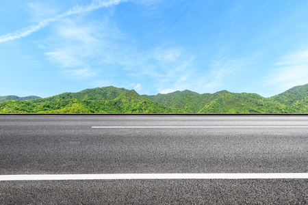 Country road and green mountains natural landscape under the blue sky Stock fotó