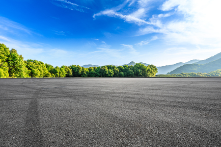 Empty asphalt race track and beautiful natural landscape