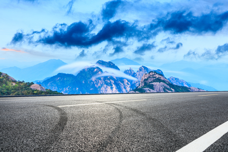 Empty asphalt road and beautiful huangshan mountains with clouds sea nature landscape