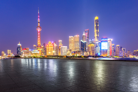 Shanghai skyline and modern city skyscrapers with empty floor at night,China