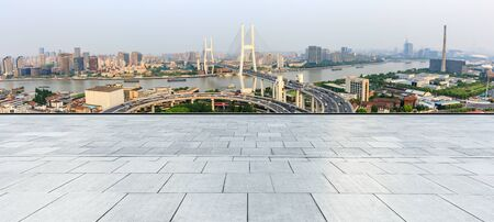Empty square floor and bridge buildings in Shanghai,China