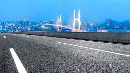 Empty highway and Nanpu bridge at night in Shanghai,China Stock fotó