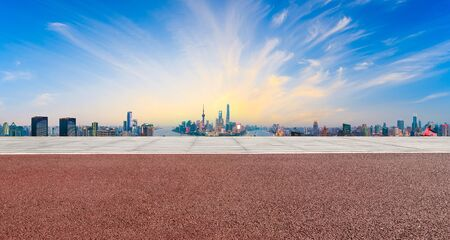 Empty square ground and modern city skyline in Shanghai at sunset,high angle view