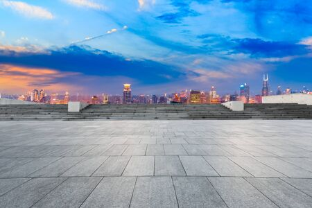Empty square floor and modern city skyline in Shanghai at sunset,high angle view