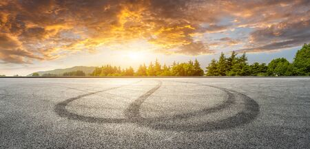 Wide race track and green woods nature landscape at sunset