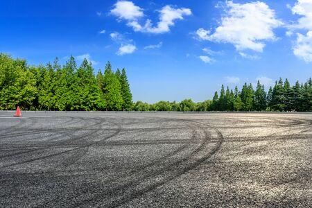 Asphalt race track and green woods nature landscape in summer