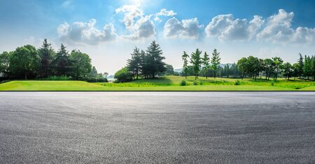Asphalt race track and green woods nature landscape in summer Stock Photo