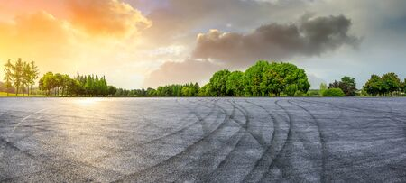Empty race track and green woods nature landscape at sunset Stock Photo