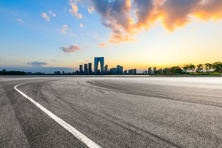 Suzhou city skyline and race track ground landscape at sunset.