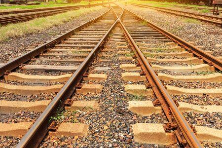 Close up low down view of railway train transport metal steel rails.