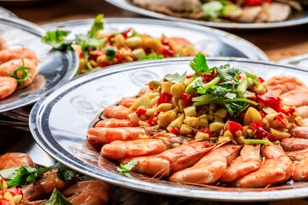Delicious chinese food poached shrimp with coriander, garlic and chili