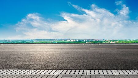 Empty asphalt highway and city suburb skyline on a sunny day in Shanghai.