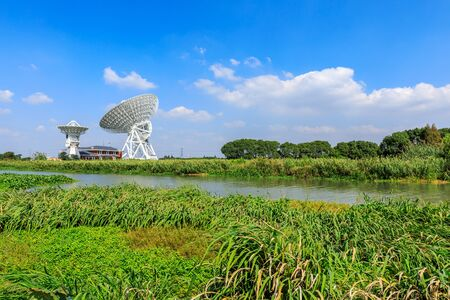 Observatory radio telescope under the blue sky in Shanghai. Stock Photo