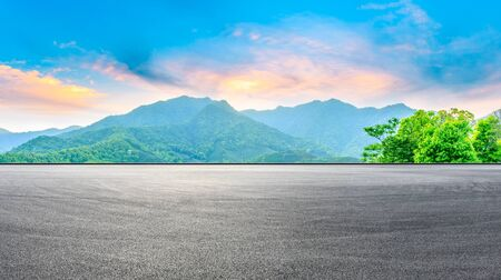 Race track road and green mountain nature landscape at sunset,panoramic view.