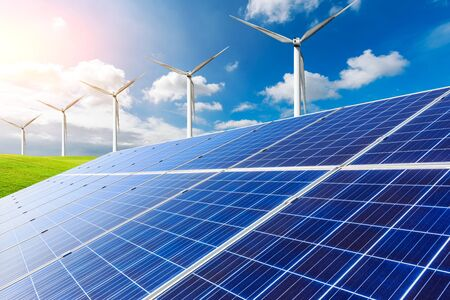 Solar panels with wind turbines on a sunny day,green clean energy concept.