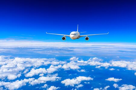 Commercial airplane flying above the clouds,travel concept.