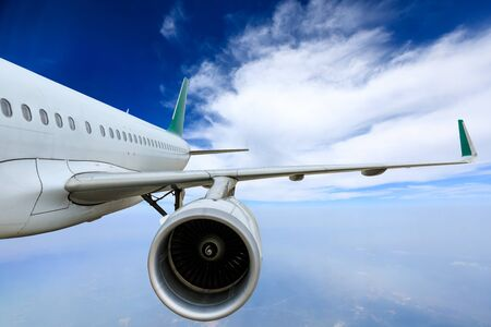 Commercial airplane flying above the clouds,travel concept. Stock Photo