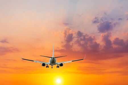 Commercial airplane flying in beautiful sky at sunset,travel concept. Banco de Imagens