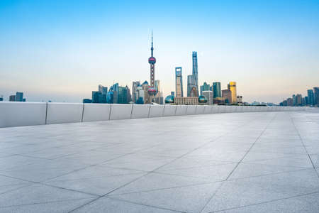 Empty floor and modern city skyline with buildings in Shanghai at sunset,China.