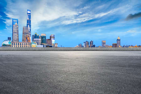 Empty asphalt road and city skyline and buildings at night in Shanghai,China. Standard-Bild