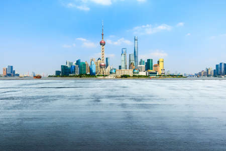 Empty asphalt road and city skyline with buildings in Shanghai,China.