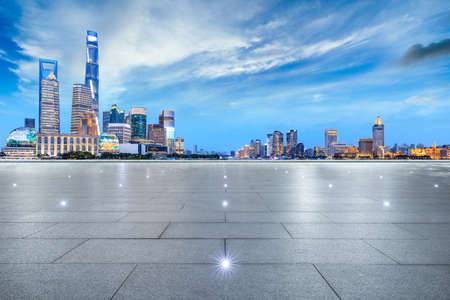 Empty square floor and city skyline with buildings at night in Shanghai,China.