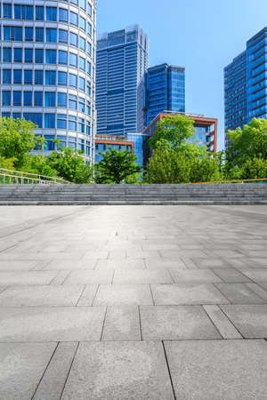Empty square floor and modern commercial buildings in Shanghai,China.
