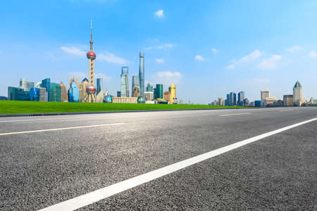 Empty asphalt road and city skyline and buildings in Shanghai,China. Standard-Bild