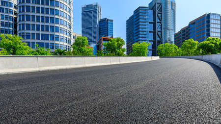 Empty asphalt road and modern commercial buildings in Shanghai,China.