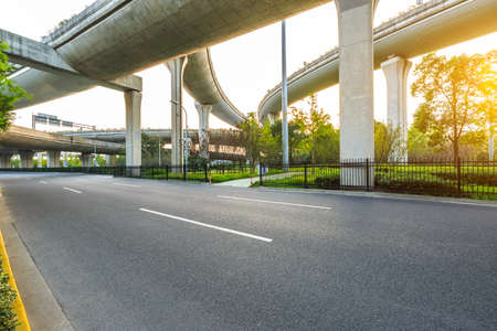 Empty asphalt road and viaduct landscape in Shanghai.
