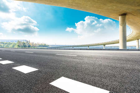 Asphalt road and viaduct with blue sky in shanghai.