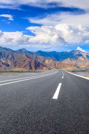 Asphalt road and mountain with sky clouds landscape.
