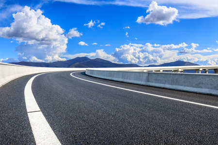 New asphalt road and mountain with sky cloud natural scenery.