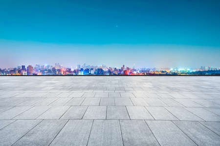 Empty square floor and city skyline with buildings in Hangzhou