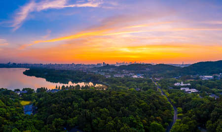 Beautiful West Lake and city skyline in Hangzhou at sunrise,China.aerial view.