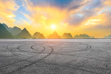 Asphalt race track and green mountain natural scenery in Guilin at sunrise,China.