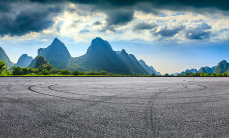 Asphalt race track and green mountain natural scenery in Guilin,China.