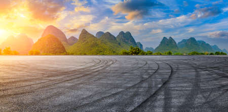 Race track road and green mountain natural scenery in Guilin at sunrise,China.