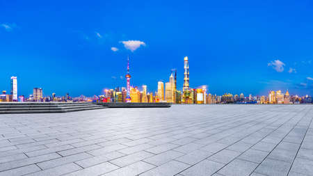 Empty square floor and Shanghai skyline with buildings at night, China.High angle view. 版權商用圖片