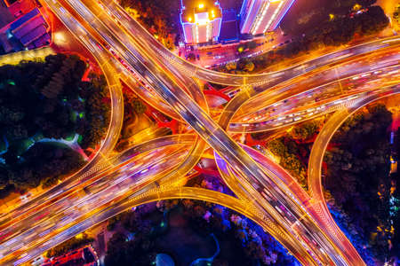 Aerial view of buildings and highway interchange at night in Shanghai,China.