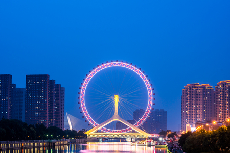 A Ferris wheel built on a bridge, located in Tianjin, China