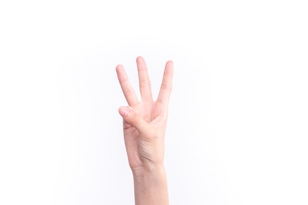 Hand gesture number three 写真素材