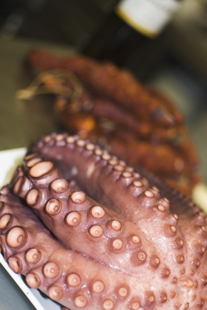 octopus cooked and presented in the table with accessories photo