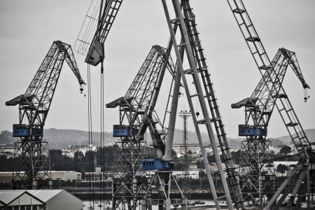 port of spain: Cranes working at the port in Ferrol, Spain