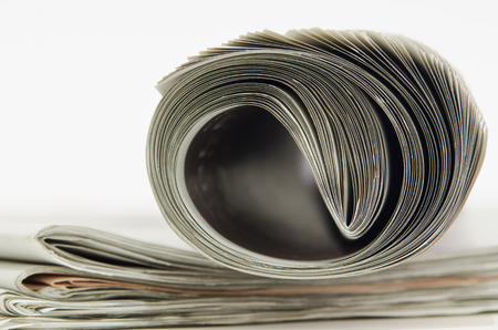 closeup of newspaper on white background photo